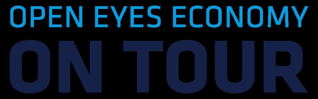 Logo a na nim napis na niebiesko Open Eyes Economy i na czarno pod spodem on tour